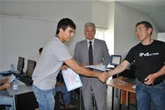 Professor Boris Japarov (centre) and KazRENA's instructor Talgat Nurlybayev (right) with training attendees from Kazakhtelecom