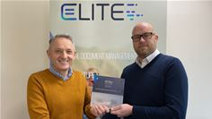 Mark Eost (M-Files), left, and Daren Parsons (Elite) celebrating Elite joining M-Files Partner Program