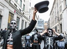 100 Skeletons march through City of London to mark end of hidden fees 1