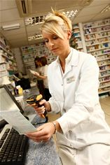 Pharmacist using MPS retail pharmacy software from McLernon Computers