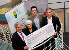 (From left to right) Ark Cancer Centre Charity trustees Merv Rees and Sandra Fell are presented with the £500,000 match-funding cheque by Ed Gairdner, chief operating officer of The Good Exchange, and Chris Boulton, chief executive officer of Greenham Trust.