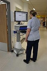 Nurse using new electronic patients record system